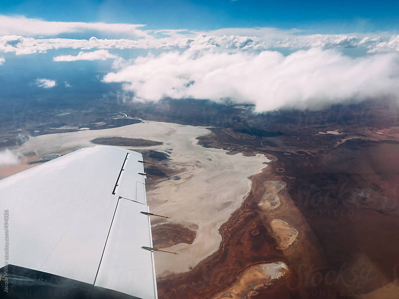 View from small aircraft over Western Australian outback with salt lake by Jacqui Miller for Stocksy United