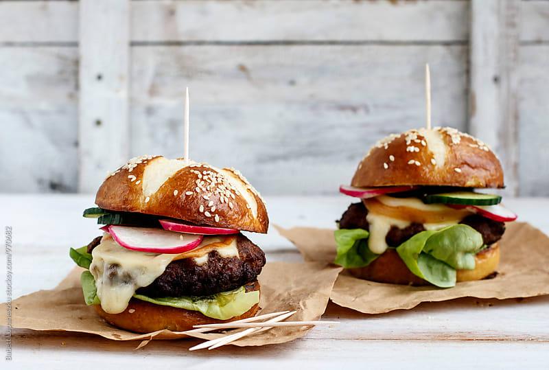 Pretzel hamburger by Babett Lupaneszku for Stocksy United
