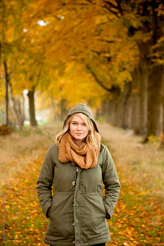 Blonde girl enjoying the autumn forest with beautiful yellow and red leaves  by Ivo de Bruijn for Stocksy United