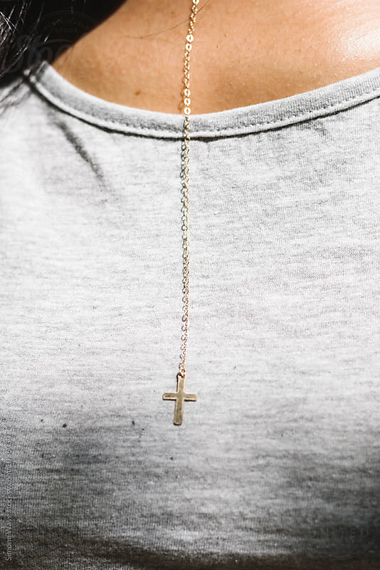 Cross necklace detail by Simone Becchetti for Stocksy United