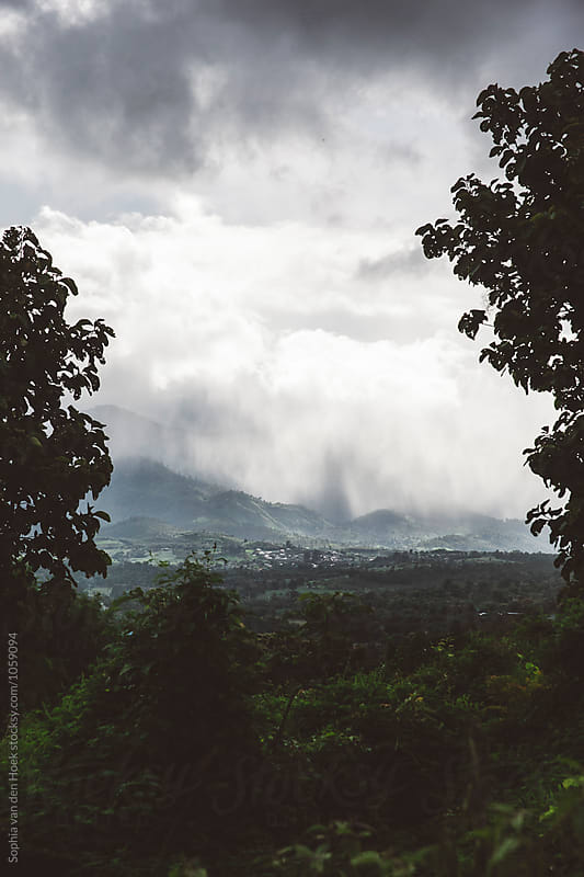 Mountain view with rain and clouds by Sophia van den Hoek for Stocksy United