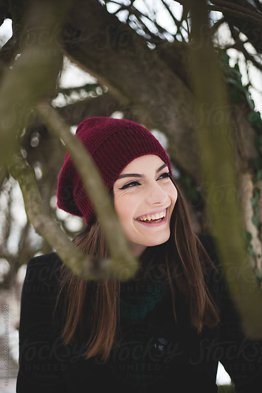 Winter portrait of a beautiful brunette by Natasa Kukic for Stocksy United