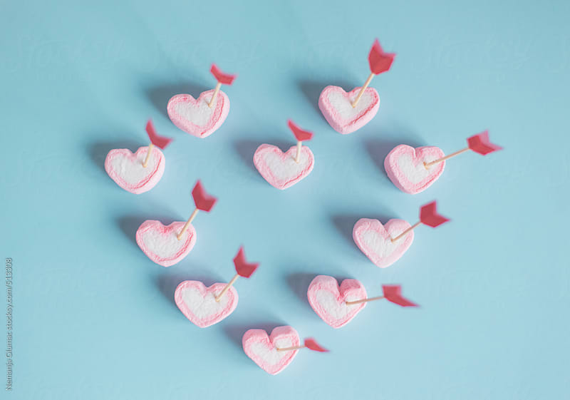 Pink Marshmallow Hearts Pierced With Cupid's Arrows by Nemanja Glumac for Stocksy United