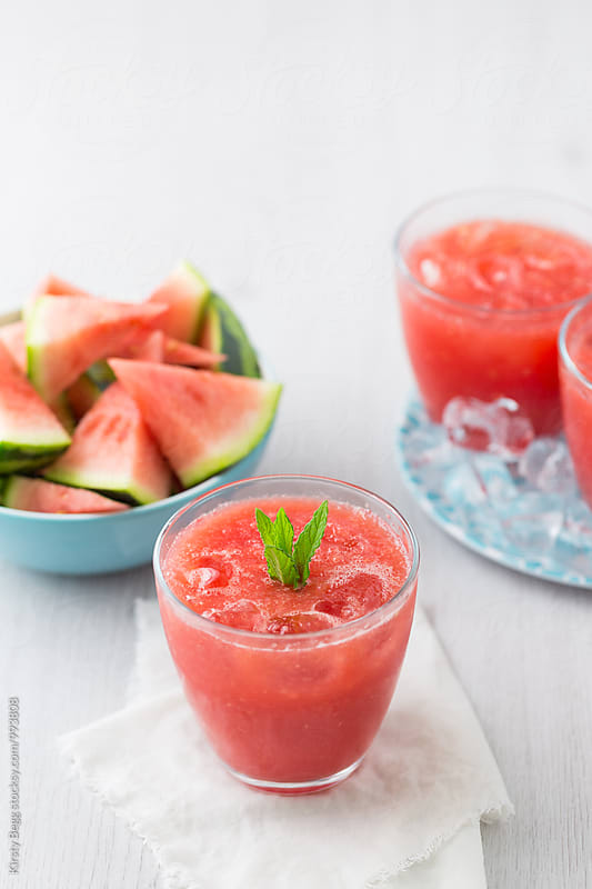 Watermelon drink with mint leaf garnish with copy space by Kirsty Begg for Stocksy United