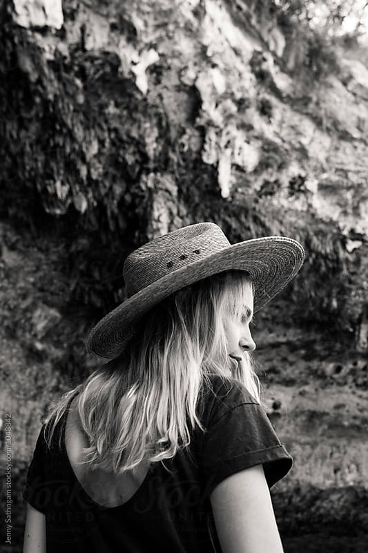 Young Blonde Woman with Straw Hat by the water by Jenny Sathngam for Stocksy United