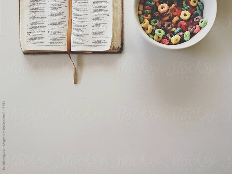 Breakfast with a bowl of cereal and bible by Kristin Rogers Photography for Stocksy United
