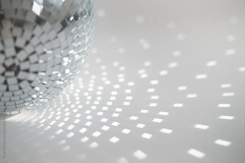 Disco ball reflection by Pixel Stories for Stocksy United