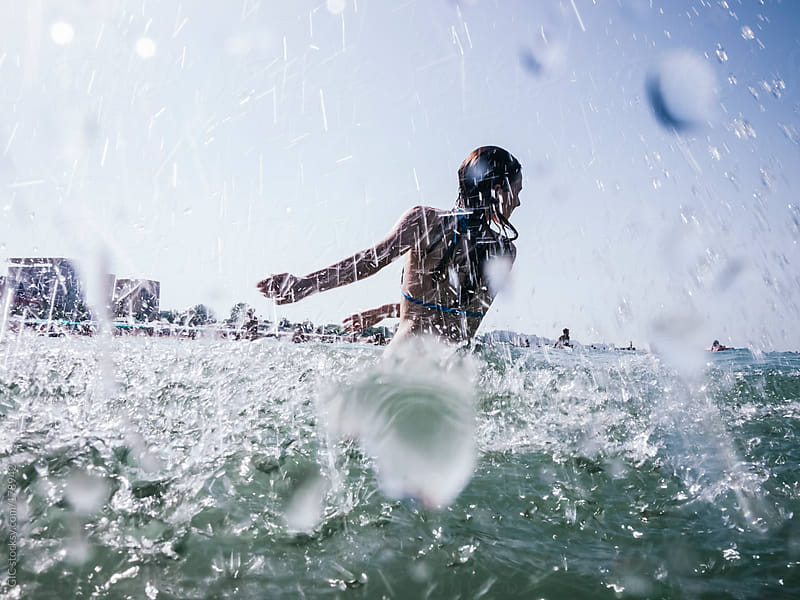 Playful young woman have fun in the sea by GIC for Stocksy United