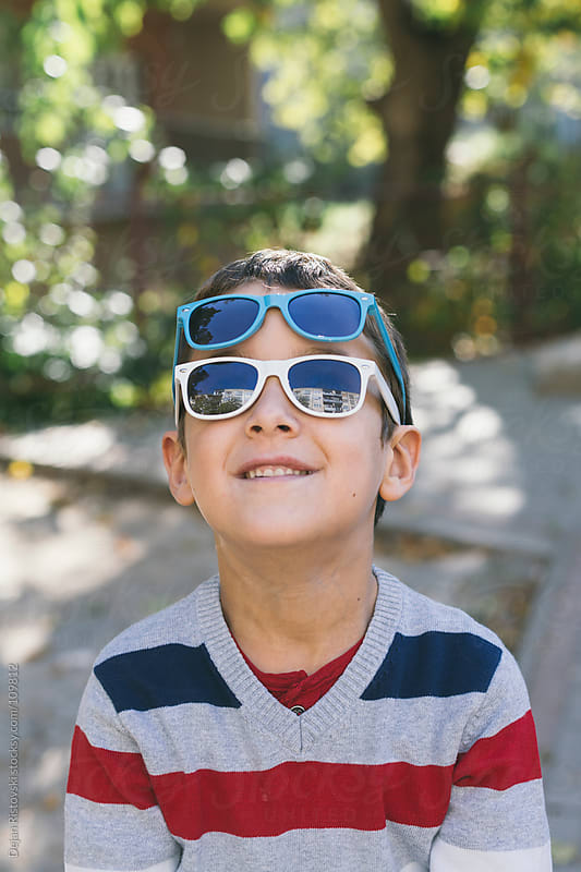 Portrait of a boy with sunglasses  by Dejan Ristovski for Stocksy United