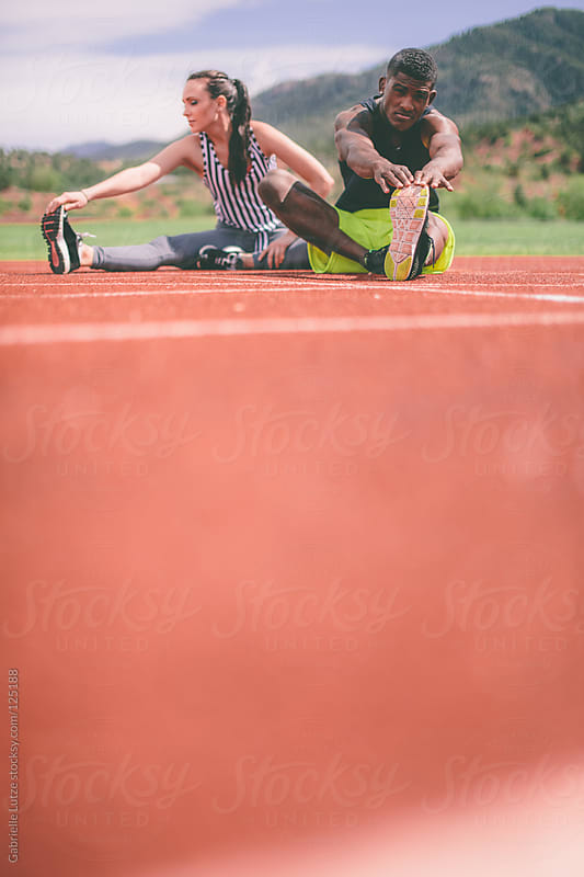 Athletic Couple on a Track  by Gabrielle Lutze for Stocksy United