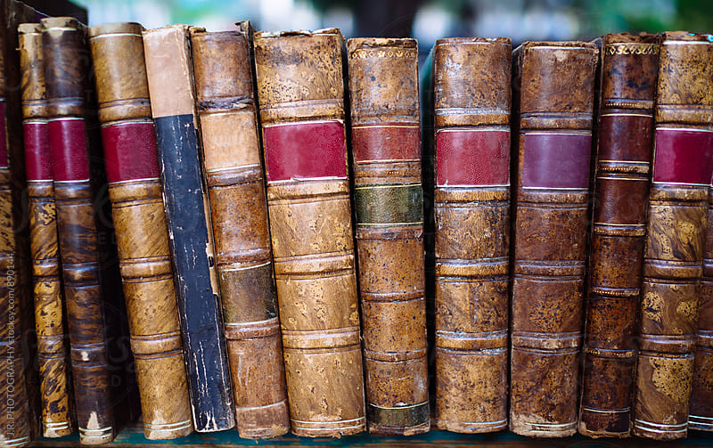 Vintage books on a library shelf by J.R. PHOTOGRAPHY for Stocksy United