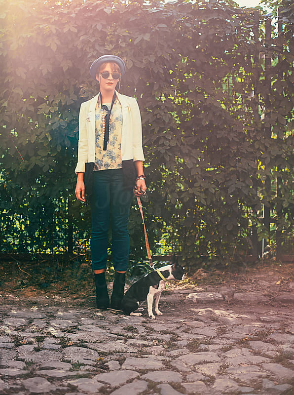 Chic Woman With Her Dog by Lumina for Stocksy United