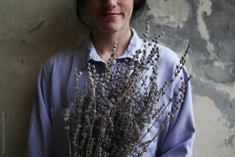 Beautiful woman holding a bouquet of lavender flowers  by Marija Mandic for Stocksy United