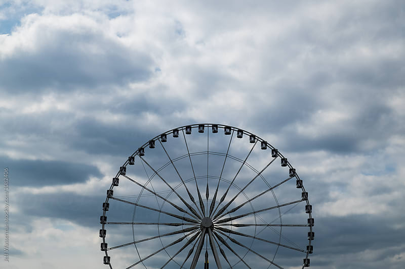 Ferris Wheel and Clouds by Jeff Wasserman for Stocksy United