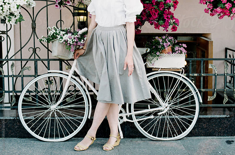Woman standing close to the bicycle by Lyuba Burakova for Stocksy United