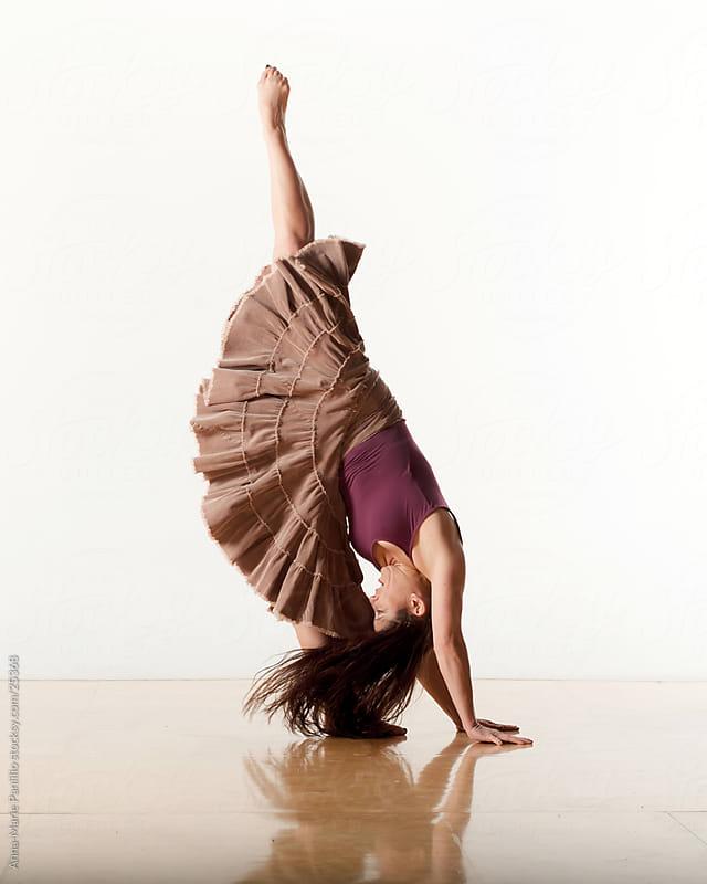 Female dancer doing the splits standing on one leg by Anna-Marie Panlilio for Stocksy United