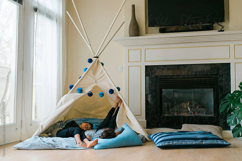 two young boys asleep in a teepee fort by Tara Romasanta for Stocksy United