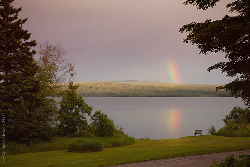Rainbow Over a Lake by Amy Drucker for Stocksy United