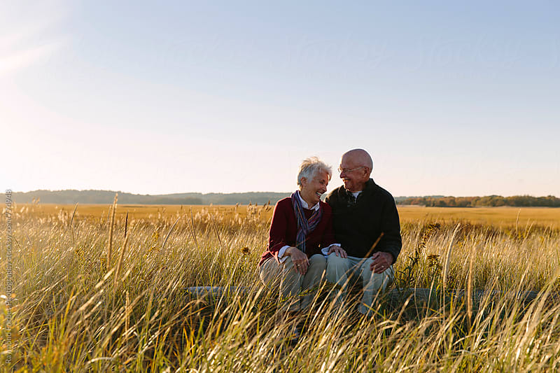 Happy Senior Couple Autumn Walk by Raymond Forbes LLC for Stocksy United