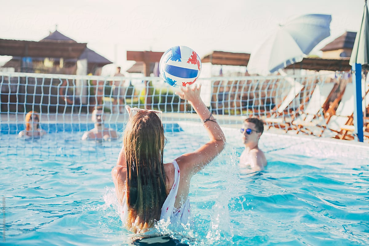 Stock Photo - Group Of People Playing Volleyball In The Swimming Pool