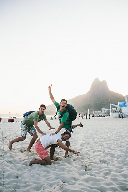 Friends having fun on the beach of Ipanema, Rio de Janeiro, Brazil by Alejandro Moreno de Carlos for Stocksy United