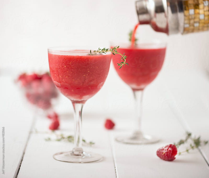 Pouring Raspberry Fruit Cocktail by Jeff Wasserman for Stocksy United