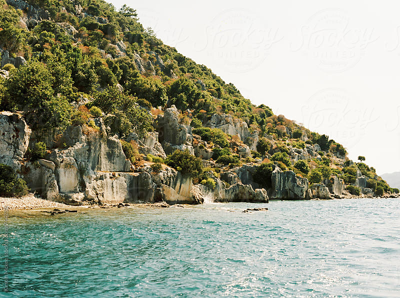 Sea and cliffs off the coast of Turkey by Kirstin Mckee for Stocksy United