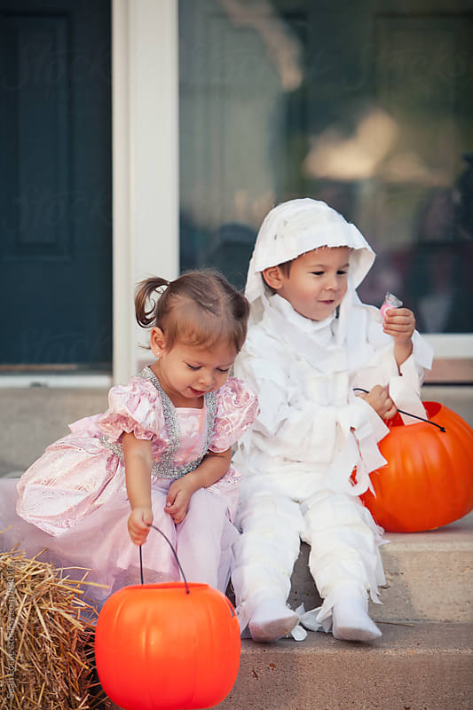 Halloween: Siblings Sitting on Front Porch by Sean Locke for Stocksy United