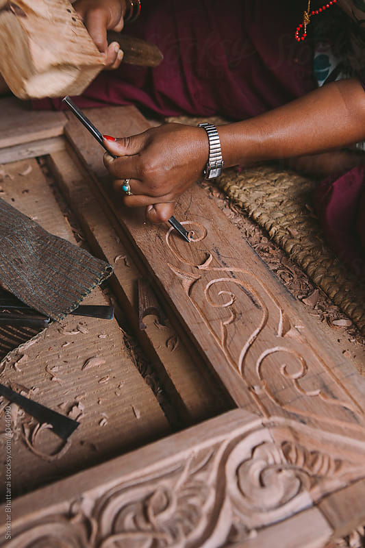 Carving a wooden door frame. by Shikhar Bhattarai for Stocksy United