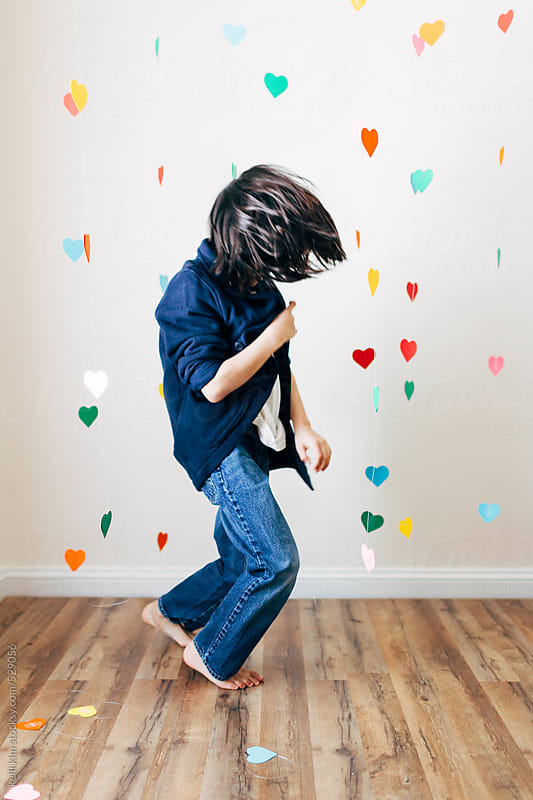 Young boy happily dancing alone by Kelli Seeger Kim for Stocksy United