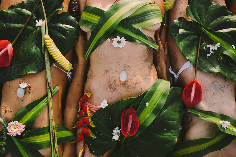 Beautiful naked female body covered with tropical flowers and plant by Nabi Tang for Stocksy United