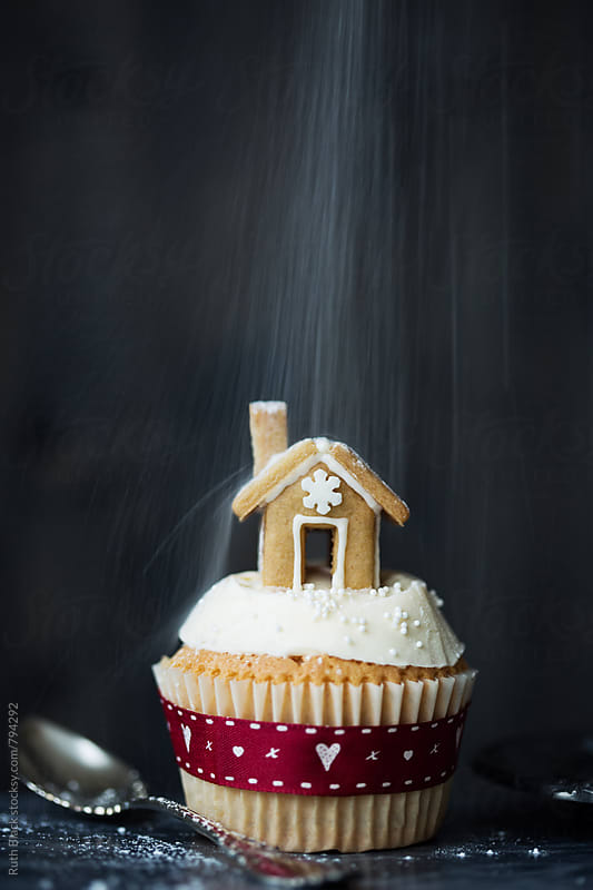 Gingerbread house cupcake by Ruth Black for Stocksy United