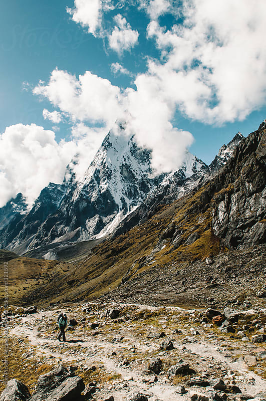 Female trekker, mountains and clouds, Everest Region, Sagarmatha National Park, Nepal. by Thomas Pickard for Stocksy United