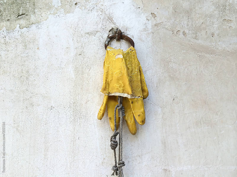 glove hanging on the wall by Tommaso Tuzj for Stocksy United