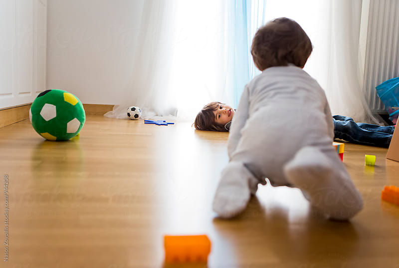 5 years old boy lying on floor   by Nasos Zovoilis for Stocksy United