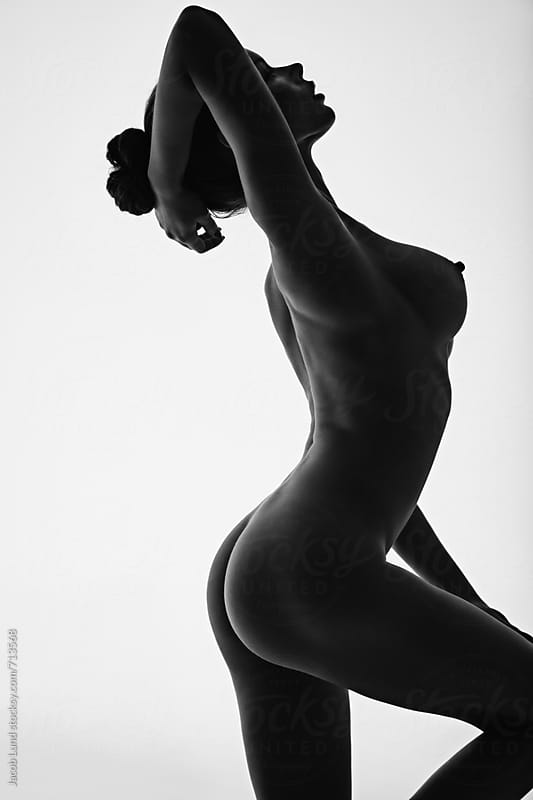 Beautiful silhouette of nude woman by Jacob Ammentorp Lund for Stocksy United