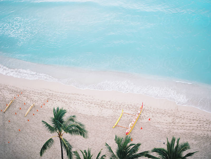 oceanscape in waikiki beach with canoes by wendy laurel for Stocksy United