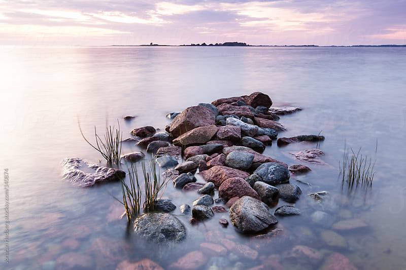 Rocks in the sea by Jonatan Hedberg for Stocksy United