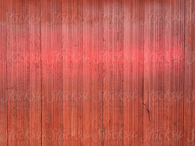 Painted red wall by Paul Edmondson for Stocksy United