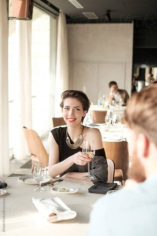 Elegant Young Woman Having Lunch at the Restaurant by Branislav Jovanović for Stocksy United