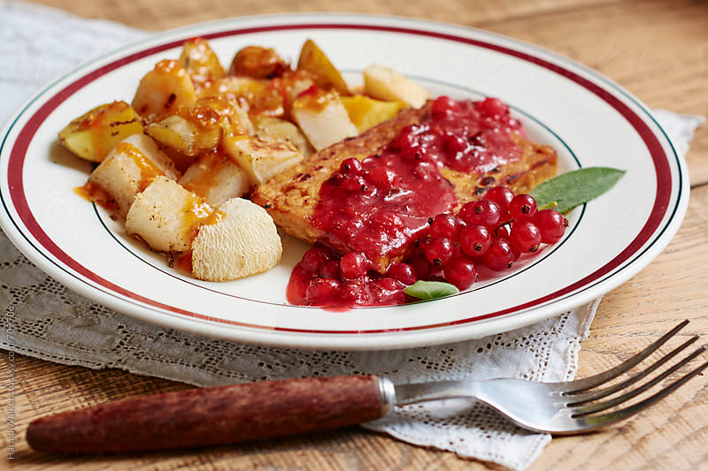 Braised Tempeh with Red current, Sage sauce by Harald Walker for Stocksy United
