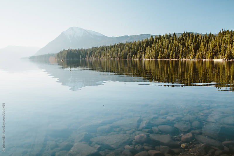 Beautiful mountain scenery and trees around the lake in morning by Justin Mullet for Stocksy United