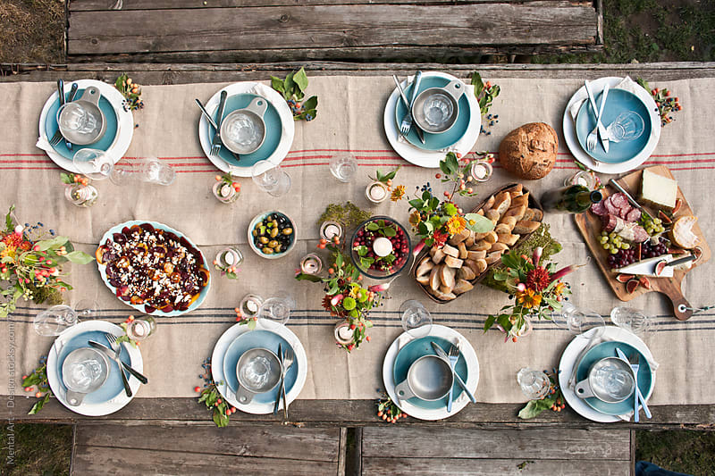 Outdoor  roast turkey dinner party by Mental Art + Design for Stocksy United