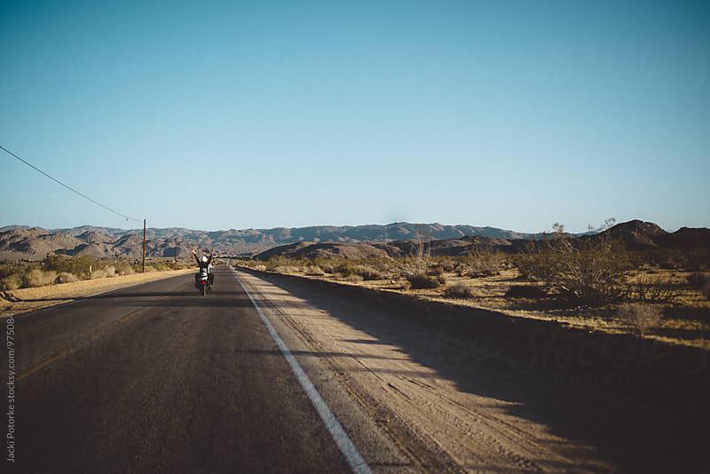 Motorcycle on open road by Jacki Potorke for Stocksy United