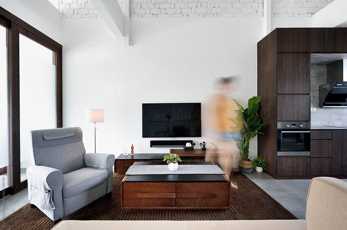 Woman Walking Through A Modern Living Room | Stocksy United