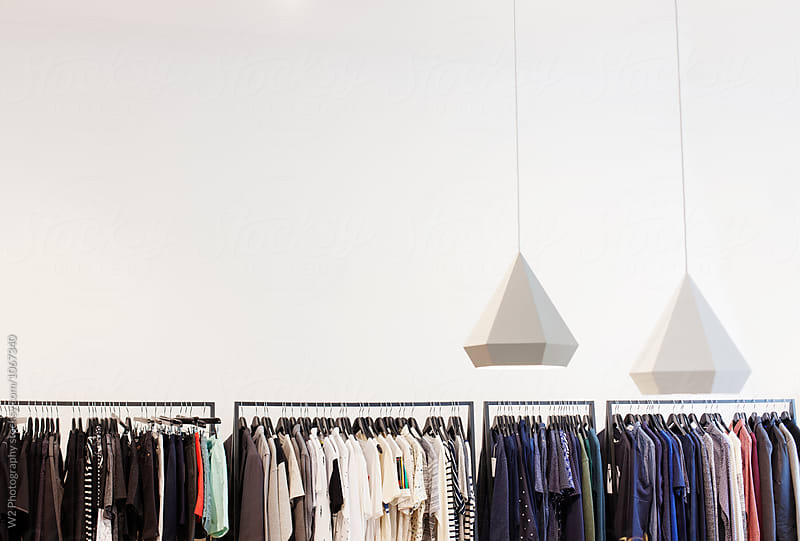 View of clothing racks in a boutique. by W2 Photography for Stocksy United