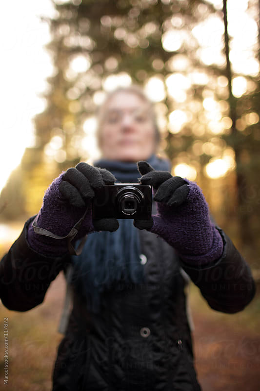 Woman taking a photograph by Marcel for Stocksy United