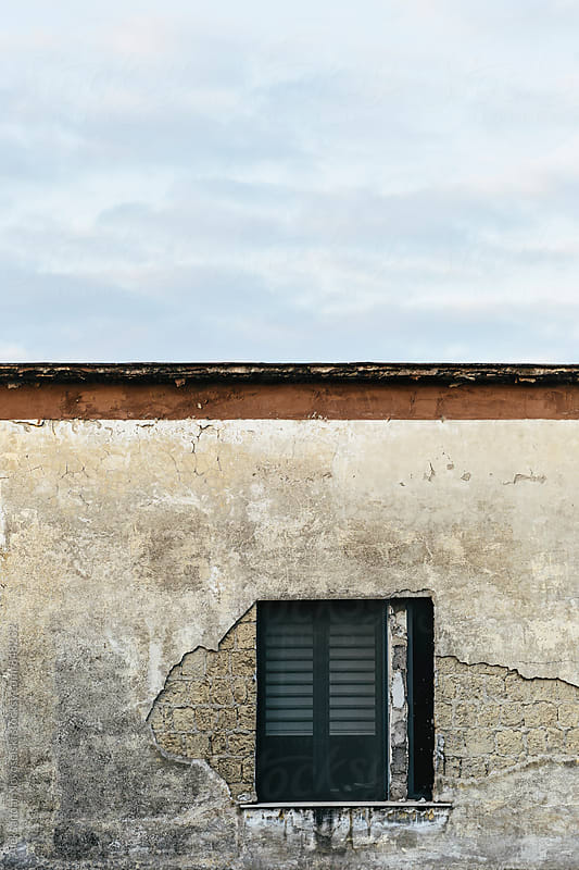 Minimalistic shot of old building with window in Italy by Aleksandar Novoselski for Stocksy United