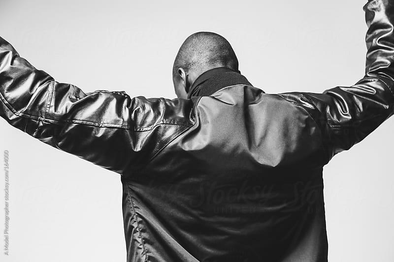 Black & white studio portraits of a fashionable young black man by Ania Boniecka for Stocksy United