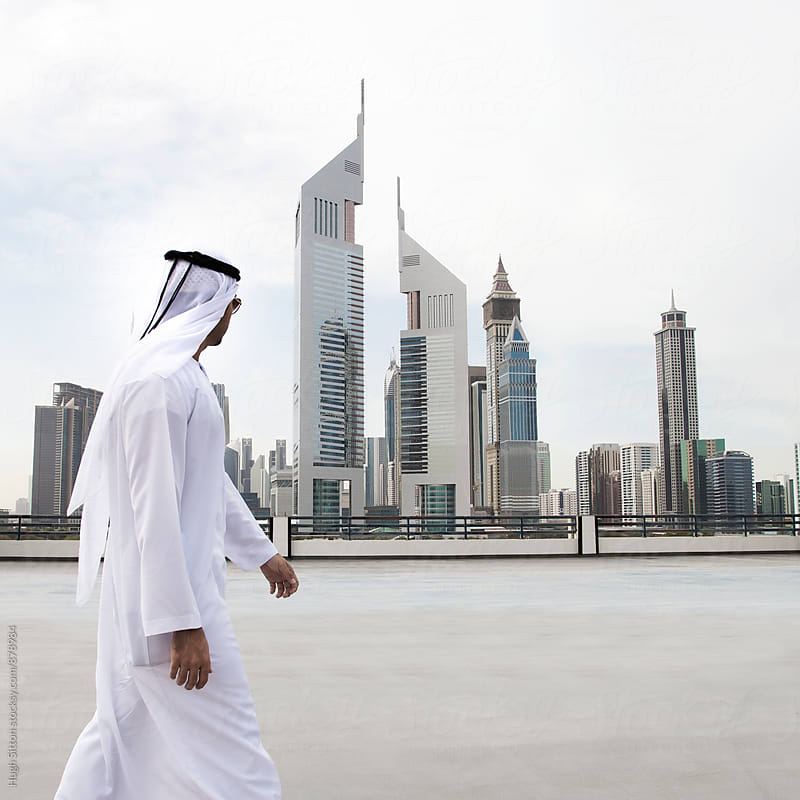 Businessman wearing traditional dress. Business district, Dubai. U.A.E by Hugh Sitton for Stocksy United